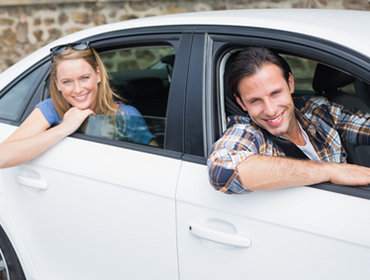 Couple driving a rental car